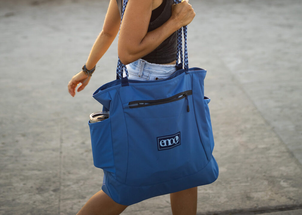 Woman walking on a city street using Relay Tote Bag.