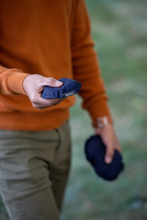 A man holds discs used to play the ENO TrailFlyer outdoor game